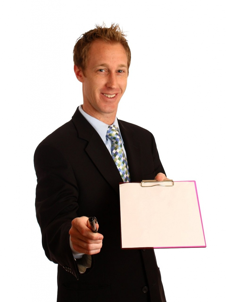 13247-a-young-businessman-holding-a-clipboard-and-pen-pv.jpg